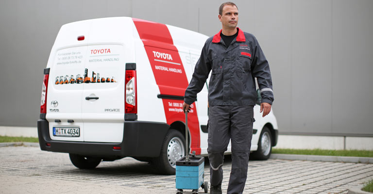 Service technician with toolbox